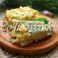 Запеченный под сыром хек с овощами